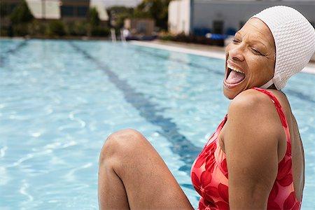 seniors and swim cap - Laughing senior woman swimmer at pool Stock Photo - Premium Royalty-Free, Code: 621-01800084