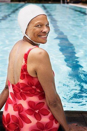 seniors and swim cap - Smiling senior woman swimmer at pool Stock Photo - Premium Royalty-Free, Code: 621-01800085