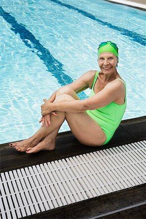 seniors and swim cap - Smiling senior woman swimmer at pool edge Stock Photo - Premium Royalty-Free, Code: 621-01800080