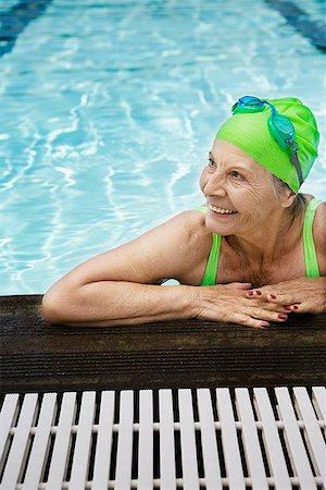 seniors and swim cap - Senior woman swimmer looking away Stock Photo - Premium Royalty-Free, Code: 621-01800082