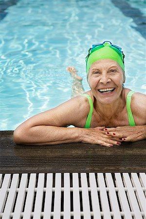 seniors and swim cap - Smiling senior woman swimmer in pool Stock Photo - Premium Royalty-Free, Code: 621-01800083