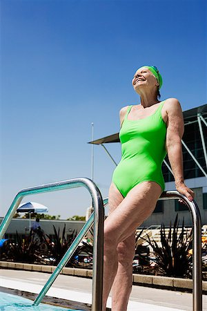 seniors and swim cap - Senior woman swimmer leaning on pool railings Stock Photo - Premium Royalty-Free, Code: 621-01800090