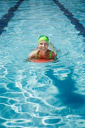 seniors and swim cap - Senior woman in swimming pool using kickboard Stock Photo - Premium Royalty-Free, Code: 621-01800114
