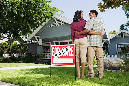 sold sign - Couple with sold sign and house Stock Photo - Premium Royalty-Free, Code: 621-01800309