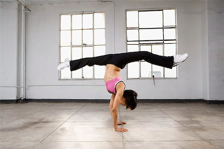 Dancer doing handstand and splits Stock Photo - Premium Royalty-Free, Code: 621-01800489