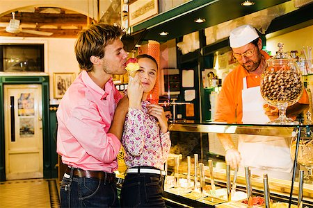 Couple and shopkeeper in gelateria, Florence, Italy Stock Photo - Premium Royalty-Free, Code: 621-01839742