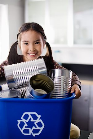 preteen  smile  one  alone - Smiling girl with recycling bin Stock Photo - Premium Royalty-Free, Code: 621-01840023