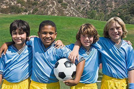 Boys' soccer team with ball Stock Photo - Premium Royalty-Free, Code: 621-02027577