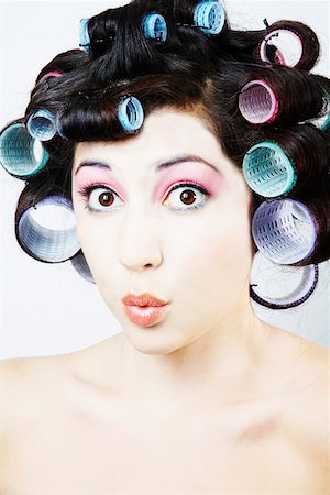 Surprised woman with hair rollers Stock Photo - Premium Royalty-Free, Code: 621-02057502
