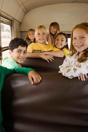 Smiling children on bus Stock Photo - Premium Royalty-Free, Code: 621-02085748