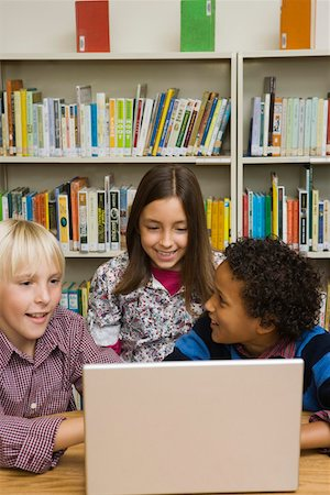 Students in library with laptop computer Stock Photo - Premium Royalty-Free, Code: 621-02085802