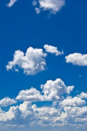 fluffy - Blue sky with fluffy clouds Stock Photo - Premium Royalty-Free, Code: 621-02085865