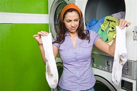 Woman holding socks Stock Photo - Premium Royalty-Free, Code: 621-02279228