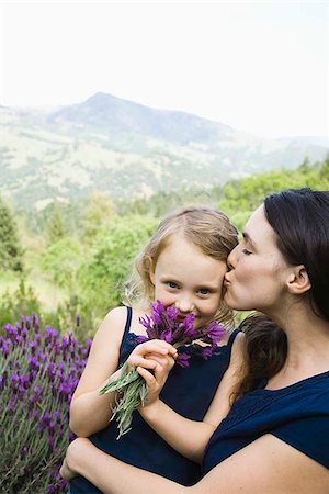 preteen kissing - Mother kissing daughter with wildflowers Stock Photo - Premium Royalty-Free, Code: 621-02357652