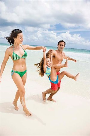 Family fun at the beach Stock Photo - Premium Royalty-Free, Code: 621-02426087
