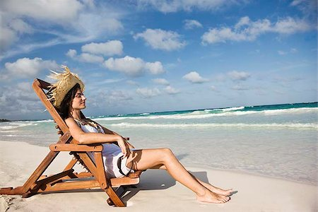Woman relaxing in beach chair by the ocean Stock Photo - Premium Royalty-Free, Code: 621-02426107