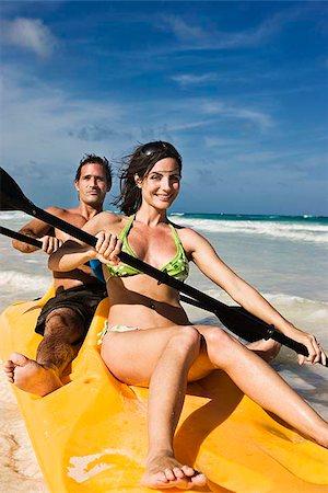 Couple canoeing in the ocean Stock Photo - Premium Royalty-Free, Code: 621-02426103