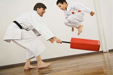 student fighting - Agility exercise in karate class Stock Photo - Premium Royalty-Free, Code: 621-02622763