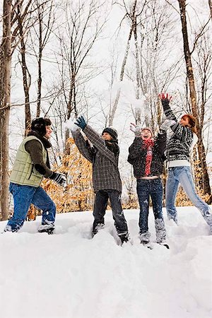 Family having snowball fight Stock Photo - Premium Royalty-Free, Code: 621-02663380