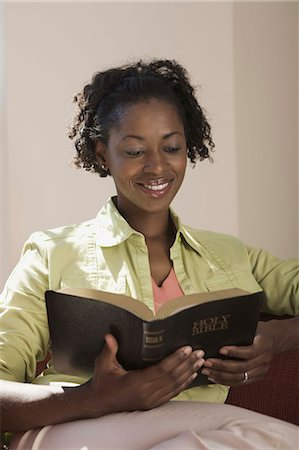 Woman reading Holy Bible Stock Photo - Premium Royalty-Free, Code: 621-03569455
