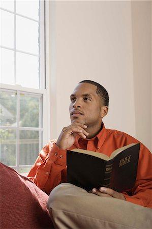 Man holding Holy Bible Stock Photo - Premium Royalty-Free, Code: 621-03569461