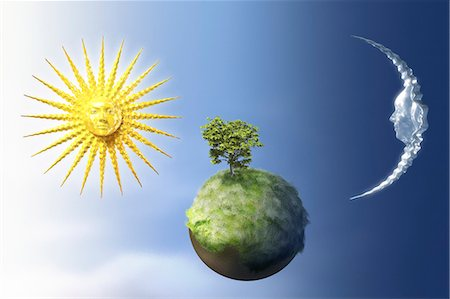 Sun and moon over a small green planet. Stock Photo - Premium Royalty-Free, Code: 621-03596503