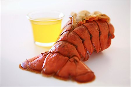 broiled lobster tail with drawn butter Stock Photo - Premium Royalty-Free, Code: 621-03596633