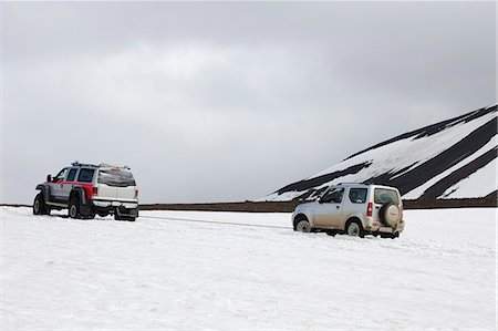 Small vehicle being towed out of the snow. Stock Photo - Premium Royalty-Free, Code: 621-03597031
