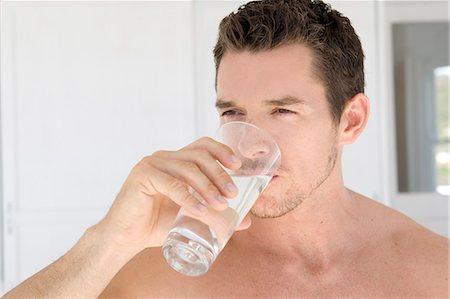 drinking water glass - Man drinking water Stock Photo - Premium Royalty-Free, Code: 621-03623460