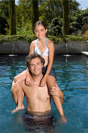Father and daughter in swimming pool Stock Photo - Premium Royalty-Free, Code: 621-03659347