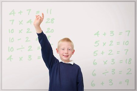 school boy raising his hand in the classroom Stock Photo - Premium Royalty-Free, Code: 621-03698725