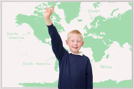 School boy with raised hand in the classroom Stock Photo - Premium Royalty-Free, Code: 621-03698726