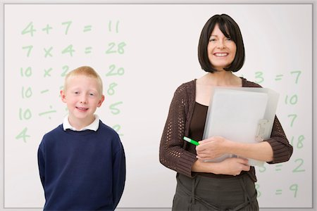 female teacher and male pupil smiling in class Stock Photo - Premium Royalty-Free, Code: 621-03698728
