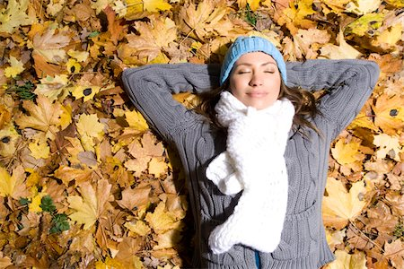 sweater - Woman lying in autumn leaves Stock Photo - Premium Royalty-Free, Code: 621-03768732