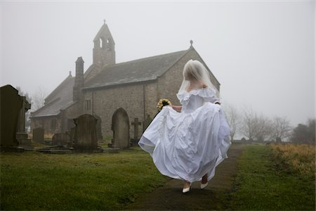 running away scared - bride running away from a church Stock Photo - Premium Royalty-Free, Code: 621-03826692