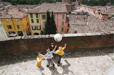 Boys Playing Soccer In Street Stock Photo - Premium Royalty-Free, Code: 622-05390959