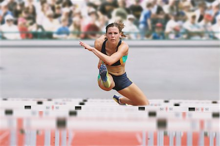 Female Runner Hurdling Stock Photo - Premium Royalty-Free, Code: 622-05602831