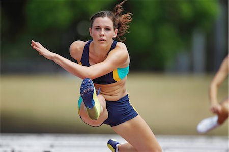 Runner Clearing Hurdles Stock Photo - Premium Royalty-Free, Code: 622-05602845