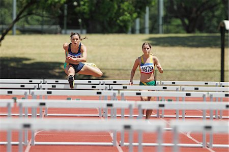 Runners In Hurdling Race Stock Photo - Premium Royalty-Free, Code: 622-05602857