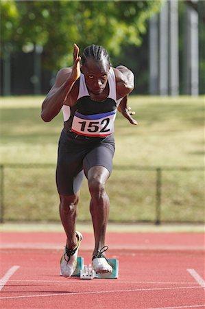 sprint - Athlete Running Away From Starting Blocks Stock Photo - Premium Royalty-Free, Code: 622-05602884
