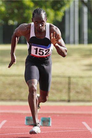runner (male) - Athlete Running Away From Starting Blocks Stock Photo - Premium Royalty-Free, Code: 622-05602885