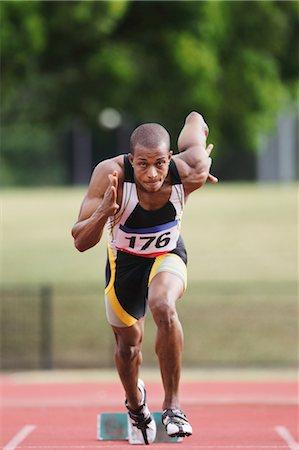sprint - Athlete Sprinting From Starting Blocks Stock Photo - Premium Royalty-Free, Code: 622-05602907