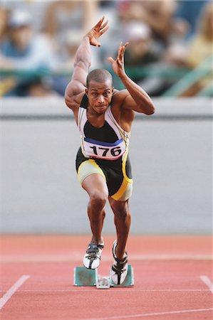 sprint - Athlete Sprinting From Starting Blocks Stock Photo - Premium Royalty-Free, Code: 622-05602911