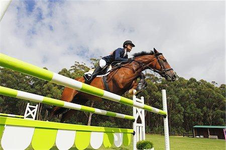 equestrian - Horse Rider Jumping Hurdle Stock Photo - Premium Royalty-Free, Code: 622-05786739