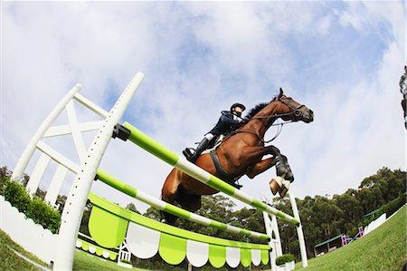 equestrian - Horseback Rider Jumping Hurdle Stock Photo - Premium Royalty-Free, Code: 622-05786732