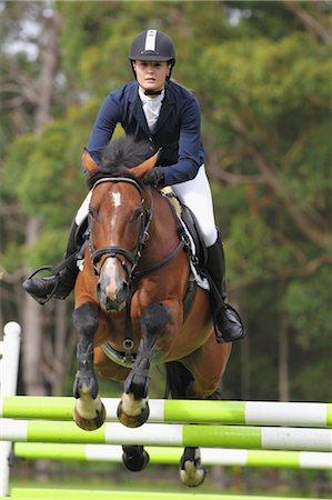 Horseback Rider Jumping Hurdle Stock Photo - Premium Royalty-Free, Code: 622-05786748