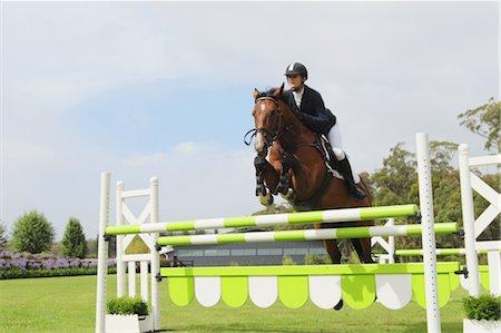 equestrian - Young Woman Horseback Rider Jumping Hurdle Stock Photo - Premium Royalty-Free, Code: 622-05786756