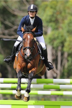 equestrian - Young Woman Horseback Rider Jumping Hurdle Stock Photo - Premium Royalty-Free, Code: 622-05786762