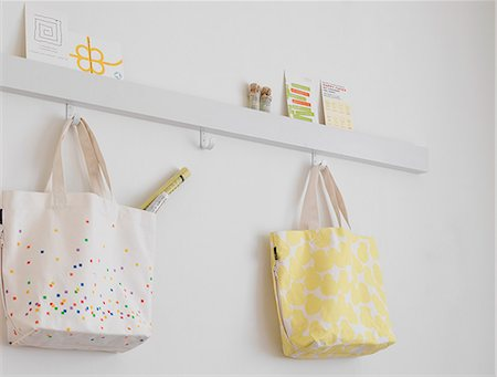 Bags Hanging In Room Stock Photo - Premium Royalty-Free, Code: 622-06009497