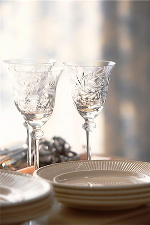Empty Drinking Glasses And Plates Stock Photo - Premium Royalty-Free, Code: 622-06009764